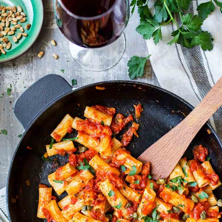 Vegan rigatoni with saffron, capers and to