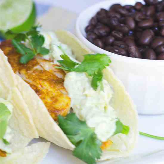 Fish tacos with creamy avocado sauce
