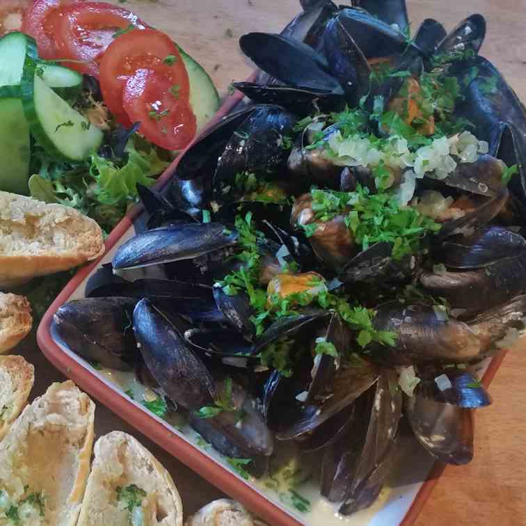 Moules mariniere with garlic and parsley s