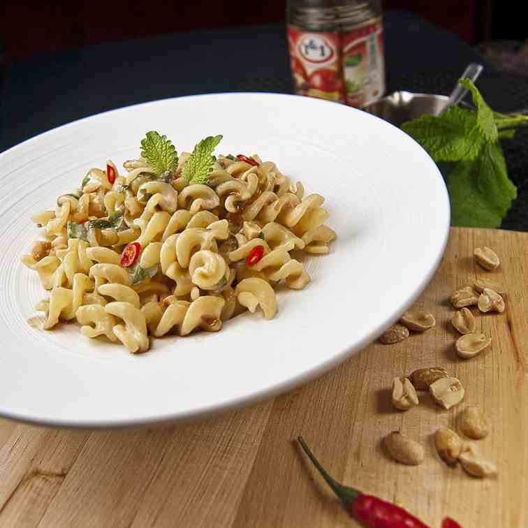 Aromatic peanut sauce over pasta