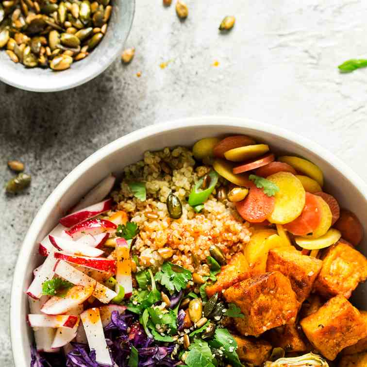 Sunny veggie bowl with harissa dressing