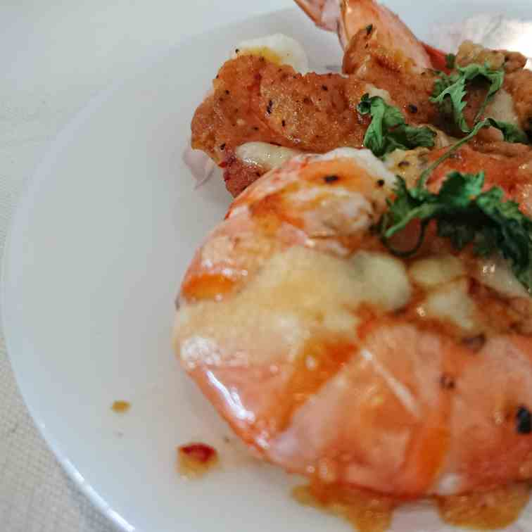 Tiger prawns baked in tomatoes and cheese