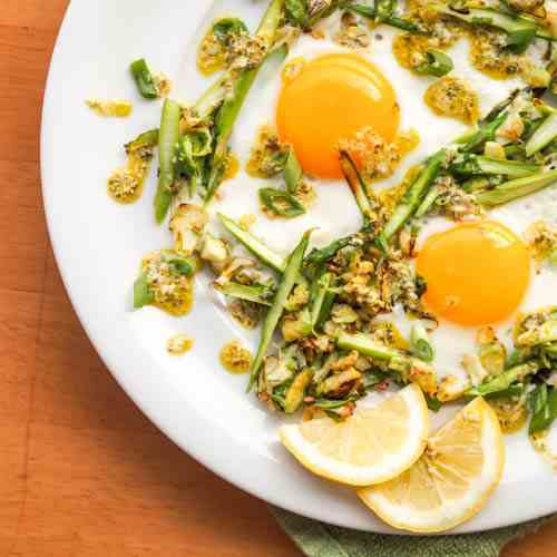 Sunny Side Up Eggs over Green Veggie Hash