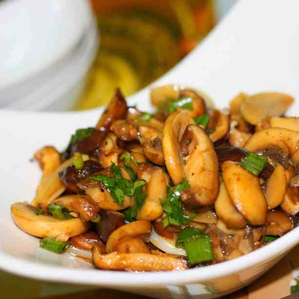 Stir fry mushroom in butter, garlic & wine