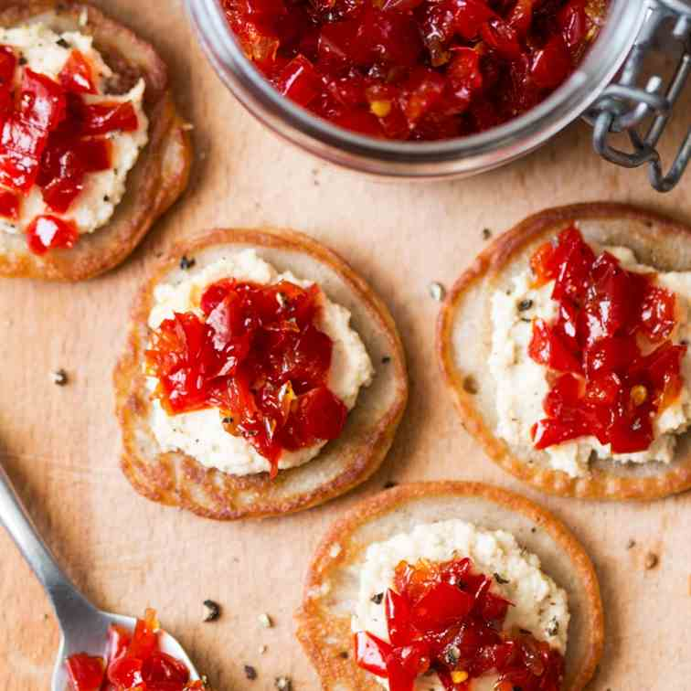 Vegan blinis with red pepper relish
