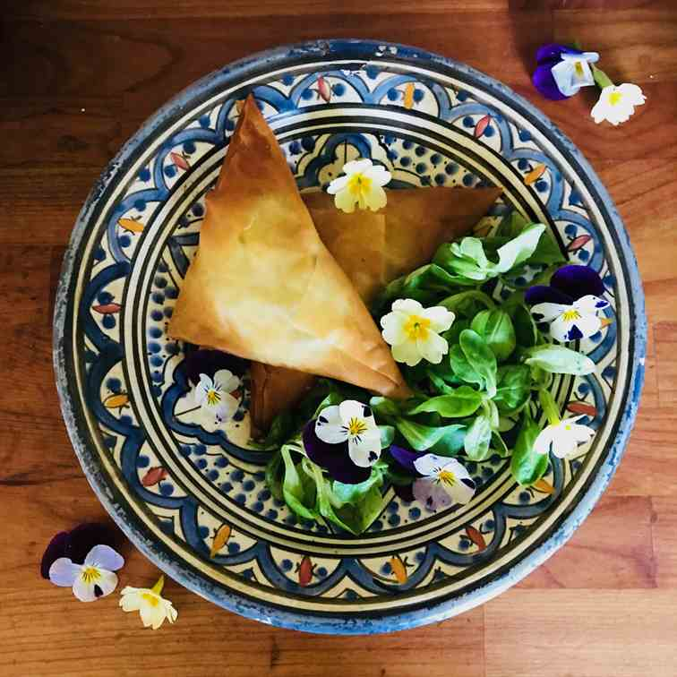 Filo triangles with edible flower salad